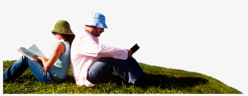 A Man And A Woman Sitting On The Grass Reading Books